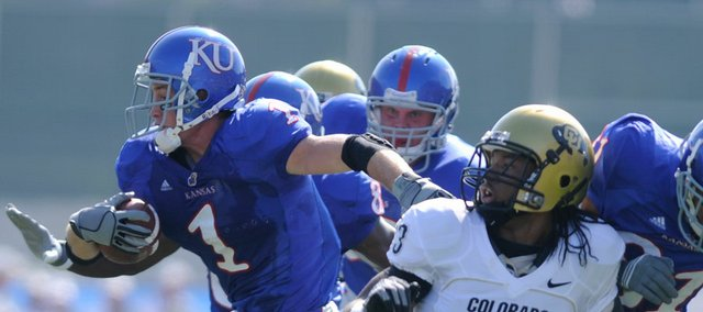 Kansas running back Jake Sharp breaks away from Colorado cornerback Jalil Brown on a 21-yard gain during the second quarter Saturday, Oct. 11, 2008 at Memorial Stadium.