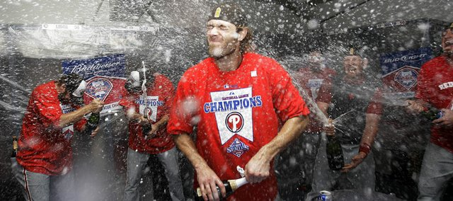 Philadelphia's Jayson Werth, center, celebrates with teammates after Game 5 of the National League championship series. The Phillies defeated the Los Angeles Dodgers, 5-1, Wednesday in Los Angeles to win the series.