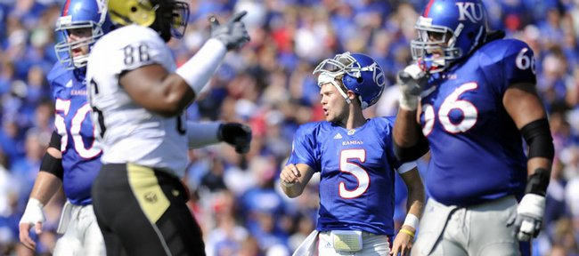 Kansas University quarterback Todd Reesing (5) barks instructions to his offense against Colorado. Perhaps the ultimate underdog, Reesing will lead the Jayhawks against heavily favored Oklahoma today in Norman, Okla.