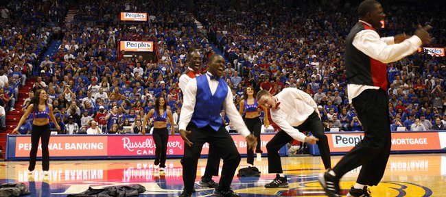 Kansas University basketball players Sherron Collins, left, Tyrone Appleton, back, Brady Morningstar, center, and Mario Little bust out some dance moves at Friday's Late Night in the Phog in Allen Fieldhouse.