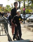 Luther Fuller, 8, and his mother, Brendy Latare, walk Saturday through downtown Lawrence in the White Cane Walk. The Douglas County Area Chapter of the National Federation of the Blind conducted the walk after White Cane Safety Day on Wednesday.