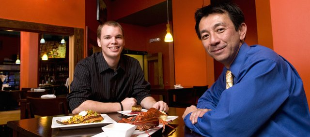 Jeff Lewis, a recent Kansas University graduate, left, and Ted Nguyen, a professional fisherman and restauranteur, have combined to create Angler's Seafood House, 1004 Mass., after noticing a void in the fish market downtown. The two owners say that they use sustainable fish and local ingredients when possible.