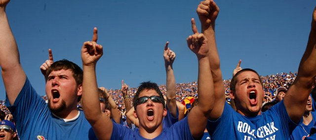 KU juniors Mark Outlaw, from left, of Olathe, Josh Petty, of Olathe, and Jordan Haught, of Tulsa, Okla., cheer before the Jayhawks enter Memorial Stadium on Saturday, Aug. 30, 2008 during KU's season-opener against Florida International.