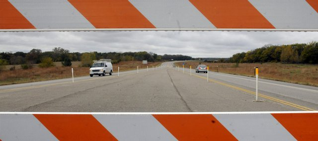 Vehicles travel on U.S. Highway 59 just south of Lawrence. A lawsuit filed Friday in federal court is the latest litigation intended to block completion of the South Lawrence Trafficway&#39;s eastern leg through the Baker Wetlands. The western segment of the trafficway ends at U.S. 59.