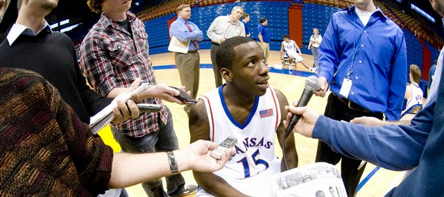 Kansas guard Tyshawn Taylor gets his first taste of Media Day as he is surrounded by reporters at Allen Fieldhouse on Oct. 17.