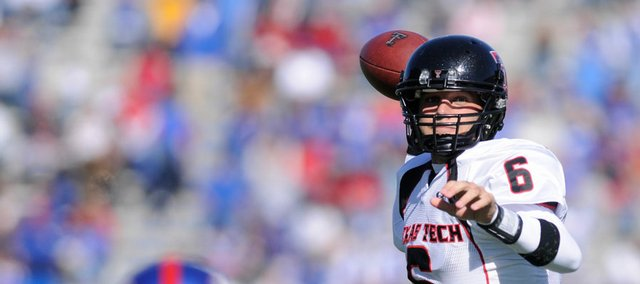 Texas Tech quarterback Graham Harrell unleashes for a receiver on Saturday, Oct. 25, 2008 at Memorial Stadium.