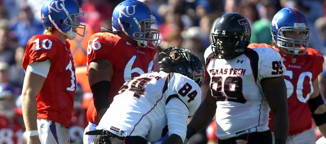 Texas Tech defensive end Brandon Williams lets out a roar in front of Kansas players Kerry Meier (10), Adrian Mayes (66) and Ryan Cantrell (50) after the Red Raiders recovered a Todd Reesing fumble during the second quarter Saturday, Oct. 25, 2008 at Memorial Stadium. Right is Texas Tech defensive tackle Richard Jones.
