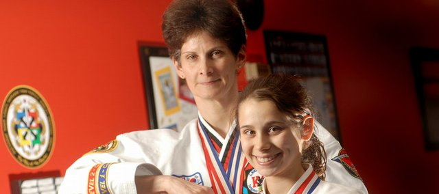 Dru Forrester, 48, and her daughter Sarah Jacobson, 13, share a love for tae kwon do. The two have won numerous awards. Sarah started at age 6 and has won a world championship.