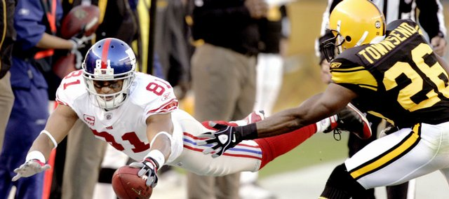 New York Giants wide receiver Amani Toomer, left, dives for a first down after making a catch, as Pittsburgh's Deshea Townsend defends. New York defeated Pittsburgh, 21-14, on Sunday in Pittsburgh.