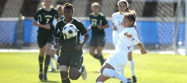 Kansas University junior Estelle Johnson, right, rears back for a kick. The Jayhawks edged Baylor, 1-0, Sunday at the Jayhawk Soccer Complex.