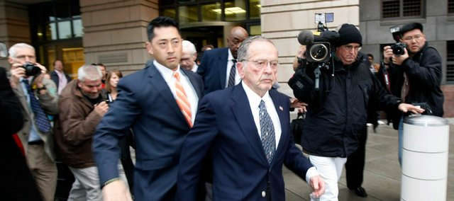 Sen. Ted Stevens, R-Alaska, leaves federal court Monday in Washington after he was convicted of seven counts of felony corruption charges. He was found guilty of accepting home renovations and other items from an oil executive and then lying about it.