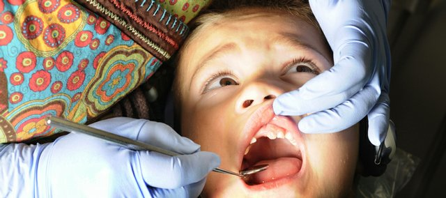 "Ben Delgado, 4, of Eudora, was getting his teeth cleaned at Growing Smiles, at 1425 Wakarusa Drive, in this 2008 file photo. Many parents are watching their children's teeth this time of year, with Halloween close at hand and lots of sweets being given out. Growing Smiles is hosting a ""Halloween Candy Buyback"" party on Nov. 3. The candy will be sent to overseas to military personnel."
