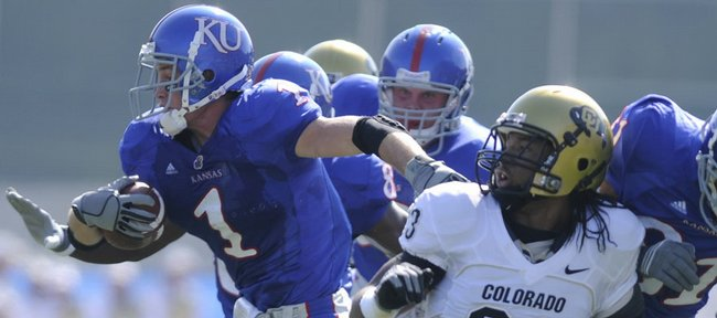Kansas running back Jake Sharp (1) breaks away from Colorado cornerback Jalil Brown (23) for a 21-yard gain in this Oct. 11 file photo in Lawrence. Sharp and K-State's Justin Woods, whose teams will face each other Saturday, have a rivalry from their days as prep track stars.