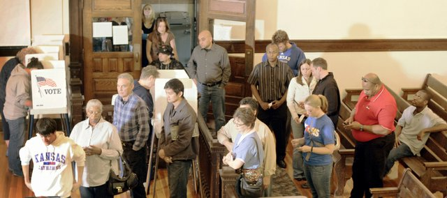 A line of advance voters winds into the Douglas County Courthouse courtroom Friday afternoon. County Clerk Jamie Shew said that on Thursday alone more than 1,100 people voted. More than 14,000 people had already cast ballots or received a mail-in ballot as of Thursday evening, said Keith Campbell, the county's elections deputy.