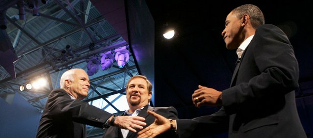 presidential candidates Sen. John McCain, R-Ariz., left, and Sen. Barack Obama, D-Ill., greet each other at an event in Lake Forest, Calif., hosted by the Rev. Rick Warren, center. KU professor Thomas Heilke says Warren has helped evangelicals focus on issues such as poverty and other social justice issues, not just abortion.