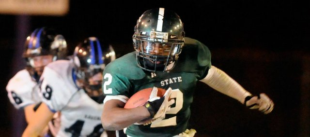 Free State high senior running back Chucky Hunter leaves the Olathe Northwest defense in the dust during a second-quarter run. Hunter rushed for 228 yards in Free State's 41-9 victory Friday at Haskell Stadium.