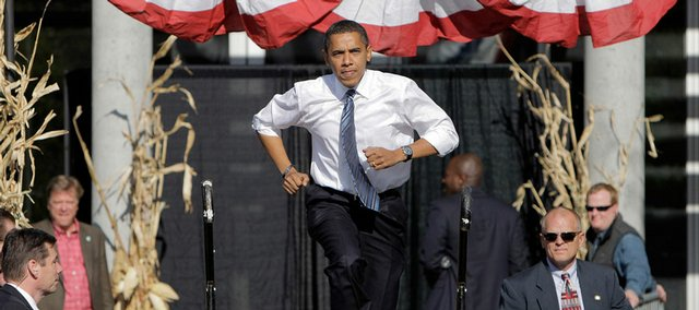 Democratic presidential candidate Sen. Barack Obama, D-Ill., arrives Friday at a rally in Des Moines, Iowa.