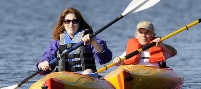 Dot Nary and her husband, Norm White, paddle the slient waters of Lone Star Lake. Nary is a Kansas University researcher and advocate on disability issues.