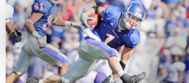 Kansas University's Jake Sharp (1) bowls over a Kansas State defender in this file photo from Nov. 1, 2008. Sharp rushed for 181 yards against the Wildcats.