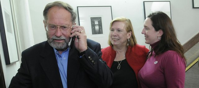 Republican Rep. Tom Sloan talks to a supporter on his phone Tuesday at the Douglas County Courthouse after defeating Democrat John Wilson in the 45th District House race. Sloan's wife, Gail, is at center, and his daughter, Lynnette Wood, is at right.