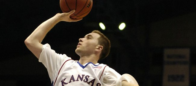 Kansas guard Brady Morningstar lines up a shot as he soars to the bucket past Washburn guard Paul Byers during the first half Tuesday, Nov. 4, 2008 at Allen Fieldhouse.
