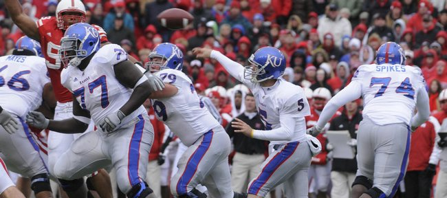 Kansas quarterback Todd Reesing (5) heaves a pass over the middle under the protection of the offensive line during the second quarter Saturday, Nov. 8, 2008 at Memorial Stadium in Lincoln..