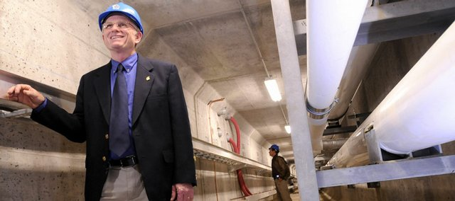 Standing in a 400-foot-long steam tunnel below the Kansas University campus, Jim Modig, KU's director of design and construction management, talks about the nearly completed first phase of a three-year project to construct new tunnels to carry steam from the power plant to heat campus buildings. The tunnels also carry electric and voice and data lines. The new tunnels replace failing tunnels that were more than 100 years old; about 10 percent of the entire network will be upgraded.