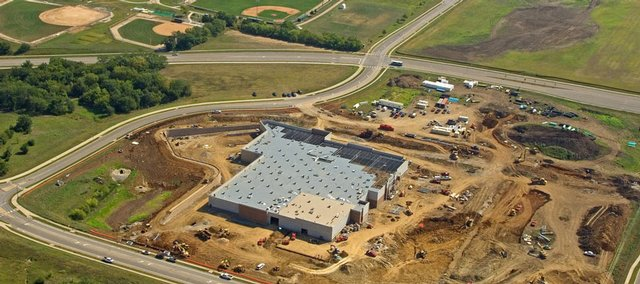 This aerial photograph shows recent progress on the Wal-Mart that's being built at the northwest corner of Sixth Street and Wakarusa Drive. Seal-O-Matic Paving Co. Inc. plans to extend its workdays on the supercenter's parking lot by 12 hours, from 5 p.m. to 5 a.m.