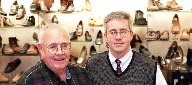 Jack Arensberg, left, a founder of Arensberg's Shoes, and Tim Arensberg pause for a portrait at the downtown Lawrence store in this 1999 file photo.
