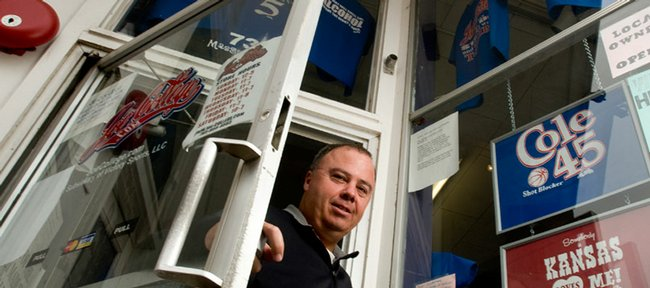 Larry Sinks, owner of JoeCollege.com, is pictured in front of his store Thursday, Nov. 13, 2008. Sinks has been in and out of the news because of his legal battles with Kansas University over licensing issues involving his t-shirts.