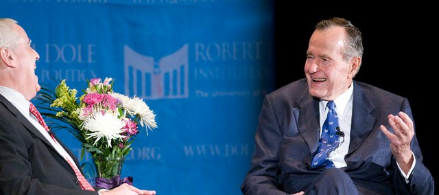 Dole Institute of Politics director Bill Lacy, left, interviews former President George H. W. Bush on Sunday, Nov. 16, 2008 at the Lied Center. Former President Bush received the Dole Leadership Prize.