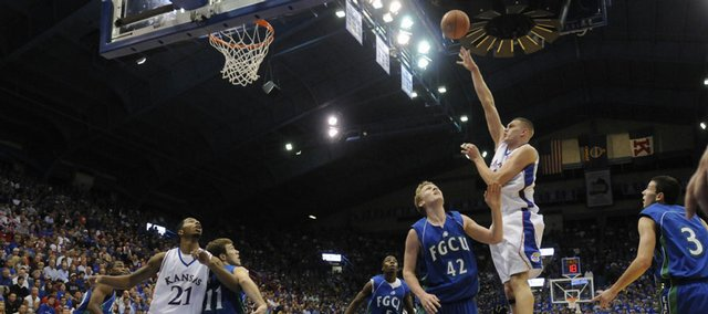 Kansas center Cole Aldrich lofts a shot over Florida Gulf Coast forward Christian Wolf for a bucket in the second half Tuesday, Nov. 18, 2008 at Allen Fieldhouse.