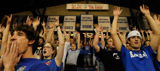 The recently unveiled 2008 national championship banner hangs in the rafters as the Kansas student section sings the alma mater prior to tipoff against Florida Gulf Coast Tuesday at Allen Fieldhouse.
