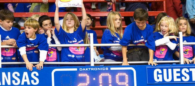 Area elementary school students come down to the railing for a closer look at the Kansas University women's basketball team playing the University Iowa at Allen Fieldhouse Tuesday, Nov. 18, 2008. After the game, some students had to chance to pose questions to several KU student athletes.