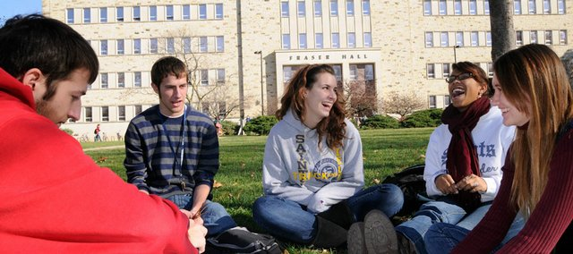 A group of KU students gather outside of Fraser Hall after class Wednesday. All five attended high school together at St. Thomas Aquinas in Overland Park and meet regularly between classes to stay in touch. From left are senior Wes Meixelsperger; his brother Erik, a freshman; and freshmen Caitlin Riley, Dallas Williams and Rose Reynolds.