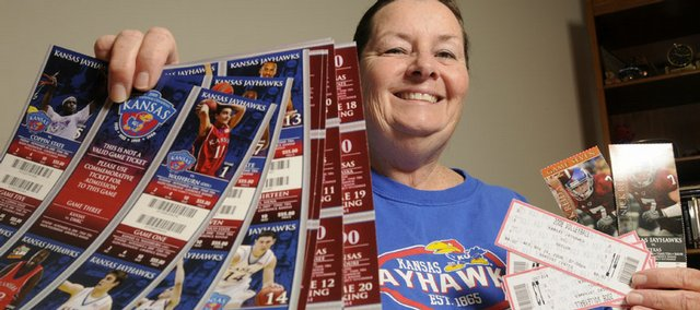 "Rusty Thomas says Kansas University athletics tickets — football, basketball and volleyball — are purchases she isn't willing to do without despite the economic downturn. ""I don't go to movies, and I don't smoke,"" says Thomas, who considers KU sports the one luxury she can splurge on."
