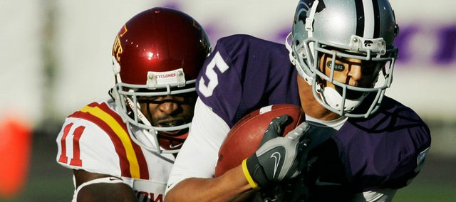 Kansas State's Ernie Pierce, right, hauls in a pass against Iowa State's Chris Singleton. Kansas State defeated Iowa State, 38-30, on Saturday in Manhattan.