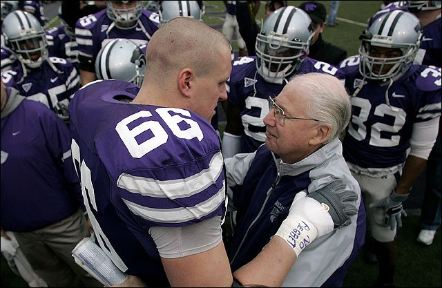 Retiring Kansas State football coach Bill Snyder talks to offensive lineman Jeremy Clary (66) before the Wildcats' game with Missouri in 2005 in Manhattan. Snyder announced his retirement after 17 years as head coach, but then announced he would return three years later.