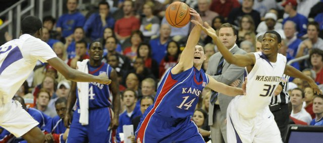 Kansas guard Tyrel Reed steals a pass intended for Washington guard Elston Turner during the first half of the CBE Classic Monday, Nov. 24, 2008 at the Sprint Center in Kansas City, Mo.