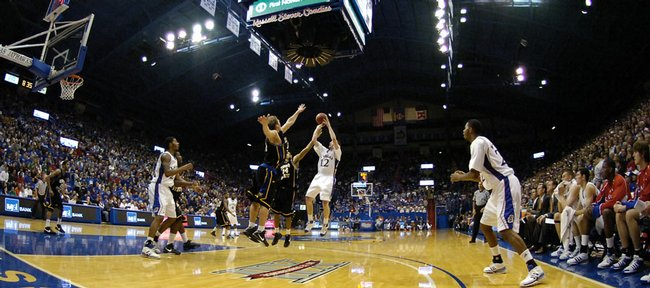 Kansas guard Brady Morningstar is fouled on the shot in the second half against Coppin State Friday, Nov. 28, 2008 at Allen Fieldhouse. Morningstar finished with a career-high 21 points and connected on six of eight three-point attempts.