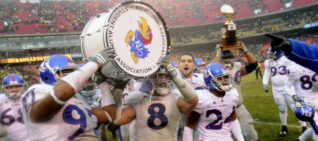 Kansas linebacker Joe Mortensen (8) and defensive tackle Richard Johnson Jr. hoist the traveling war drum trophy following the Jayhawks 40-37 victory over rival Missouri, Saturday, Nov. 29, 2008 at Arrowhead Stadium.