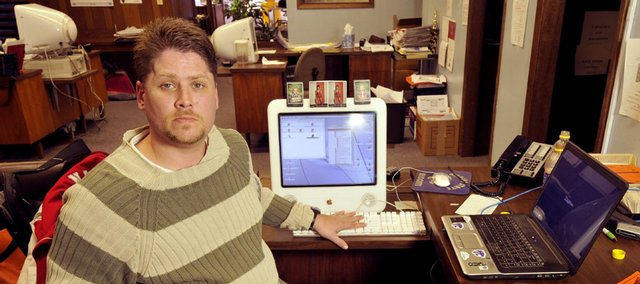 Abilene Reflector-Chronicle sportswriter Chris Orr is seen at his desk in Salina, Kan., Tuesday, Nov. 25, 2008. Orr, who covers local sports in Abilene and Dickinson county schools, survived a traumatic head injury.
