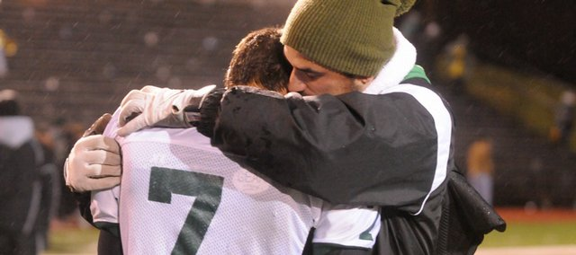 Free State player Taylor Stuart gets a hug after the Firebirds were defeated by Junction City for the state 6A state football championship in Topeka. Free State lost 19-14.