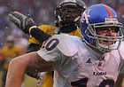 Tom Keegan: Gamblers on Kansas football spell ATS with a P and a U
