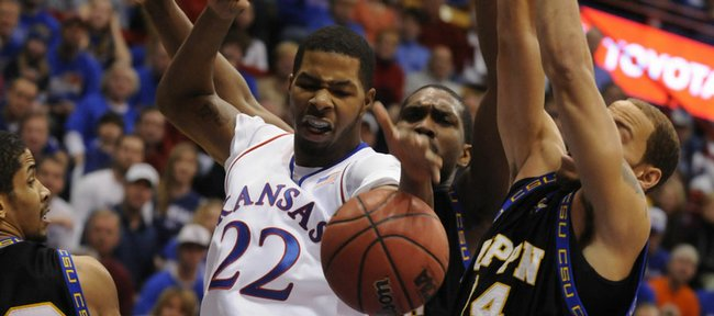 Kansas forward Marcus Morris fights for the ball with the Coppin State defense during the first half Friday, Nov. 28, 2008 at Allen Fieldhouse.