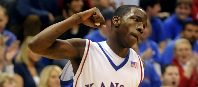 Kansas guard Tyshawn Taylor pumps his fist after a bucket against New Mexico State during the second half Wednesday, Dec. 3, 2008 at Allen Fieldhouse.