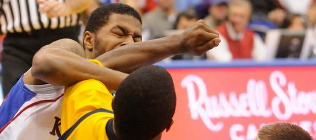 Kansas University freshman Markieff Morris takes an elbow from Kent State's Chris Singletary during Monday's game at Allen Fieldhouse. After retaliating, Morris was ejected from the game.
