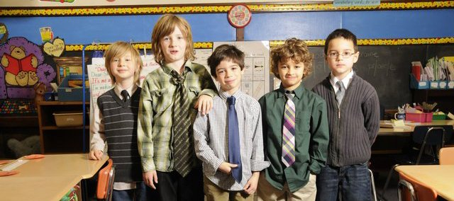 Wyatt Carson, center, a second-grader at Pinckney school, started a fashion fad after choosing to wear a tie to school. Now several second-graders are wearing ties. In class Wednesday, Dec. 3, 2008, from left are Milo McKay, Arthur Hughes, Carson, Oliver Broce and Hunter Jones.