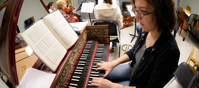 Christy Miller plays the harpsichord during rehearsal with Kansas University's Collegium Musicum. The ensemble is an early-music group that plays instruments from previous generations. It has a concert scheduled for 7:30 p.m. Thursday at Bales Organ Recital Hall on KU's West Campus.