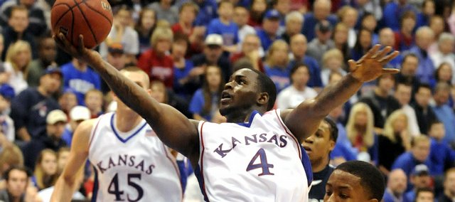 Kansas guard Sherron Collins adjusts his shot as he soars to the bucket past Jackson State guard Rod Melvin during the second half Saturday, Dec. 6, 2008 at Allen Fieldhouse.